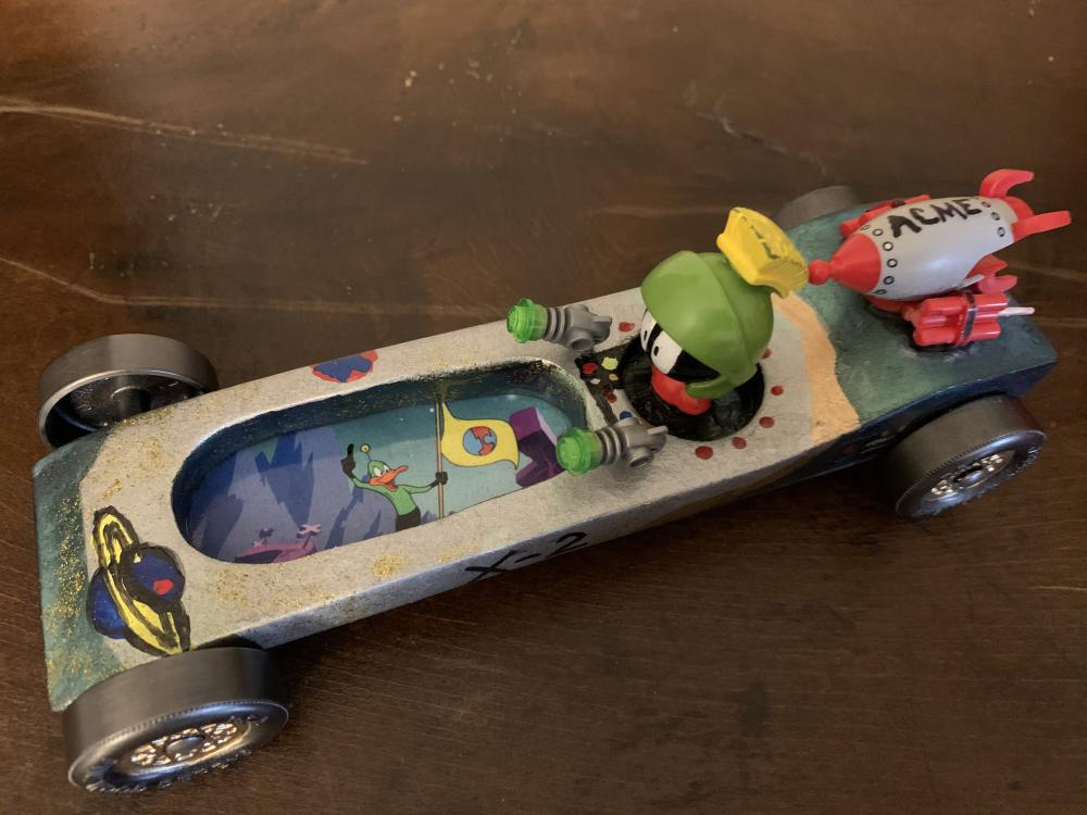 This is our Marvin the Martian pinewood derby car that was entered in the friends and family division of our pinewood derby race for Cub Scouts. It was inspired by the classic cartoon Duck  Dodgers in the 24th and a half century. It's been fun introducing my son to the classics with Toon in to Me!